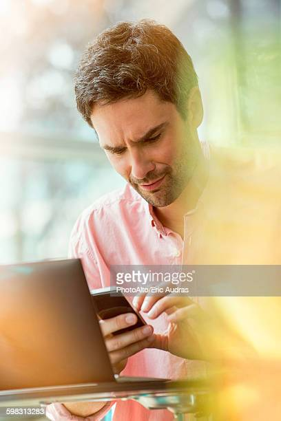 Man receiving text message