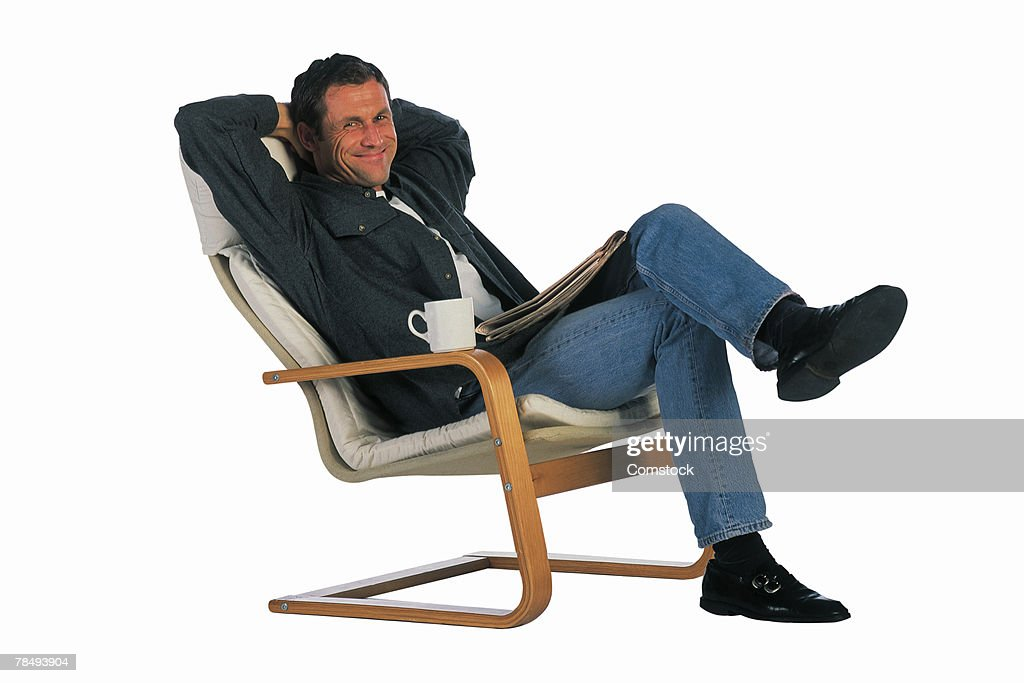 Man Reclining In Chair Stock Photo   Getty Images  sc 1 st  Apartment Dining Room Decorating Ideas & Beautiful Person In Recliner Contemporary - Home Design Ideas ... islam-shia.org