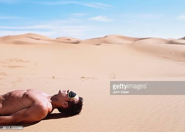 Man Reclining in Desert