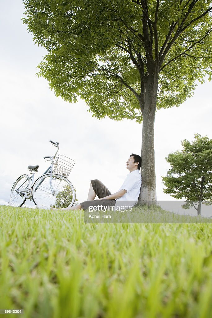 man relaxed at park : Stock Photo