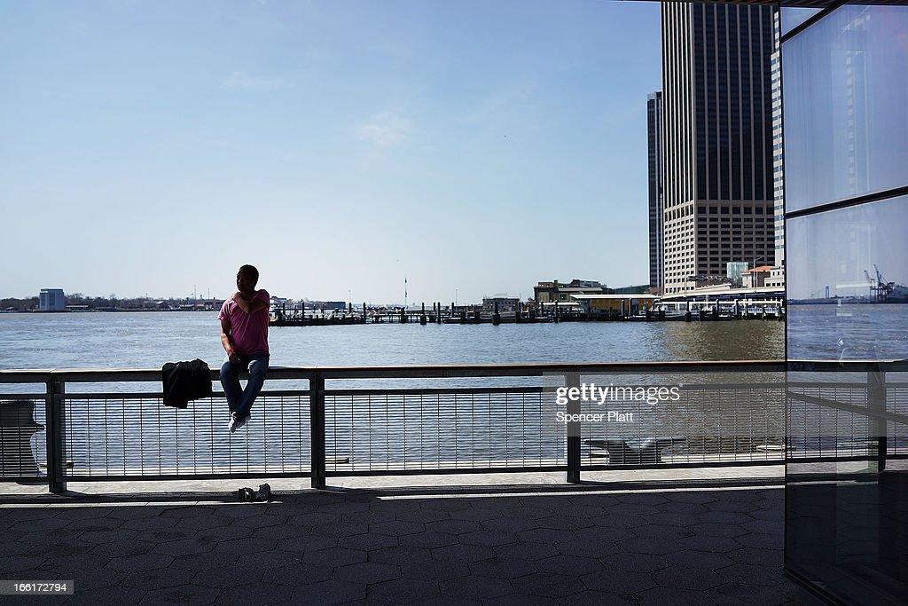 A man relaxes along the East River in lower Manhattan during warm weather on April 9, 2013 in New York City. For the first time since October, temperatures are expected to rise above 70 degrees this week in New York and surrounding areas.
