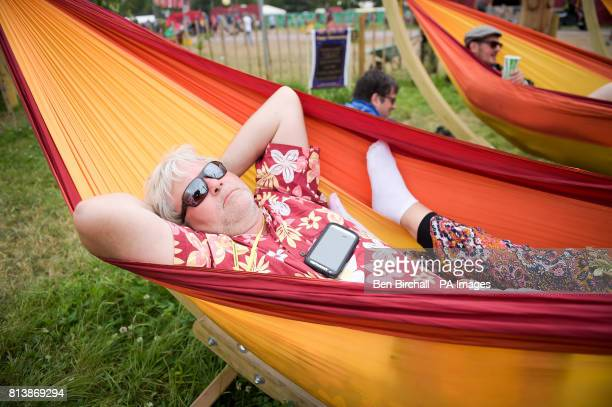 A man relaxes in a hammock at Glastonbury Festival Worthy Farm Somerset PRESS ASSOCIATION Photo Picture date Sunday June 2017 Photo credit should...
