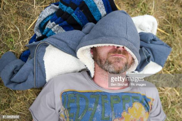 A man relaxes in the Theater area at Glastonbury Festival Worthy Farm Somerset PRESS ASSOCIATION Photo Picture date Sunday June 2017 Photo credit...