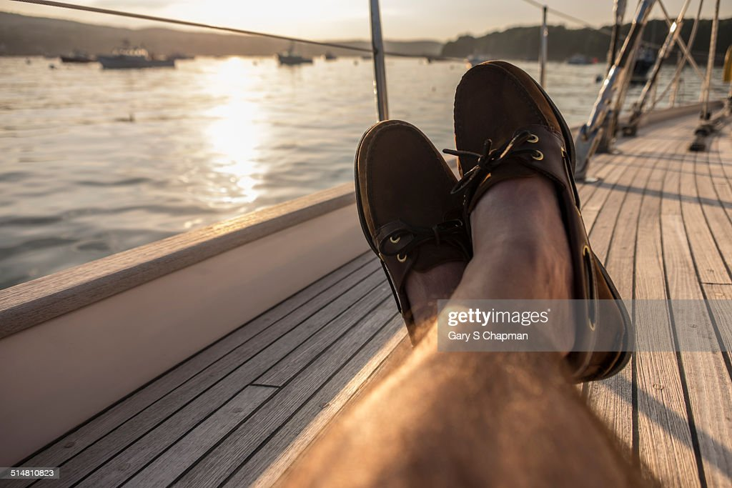 Man relaxes on sailboat