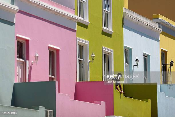 A man relaxes outside his house in the BoKaap area of Cape Town on October 20 2009 in Cape Town South Africa The BoKaap area is a predominantly...