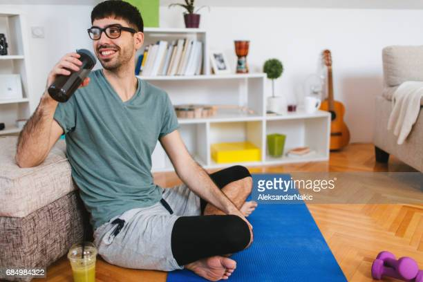 Man relaxing after workout at home