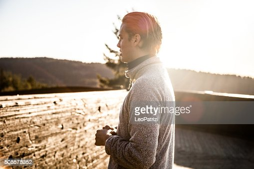 Man relaxing after workout on the hills around Oslo : Stock Photo