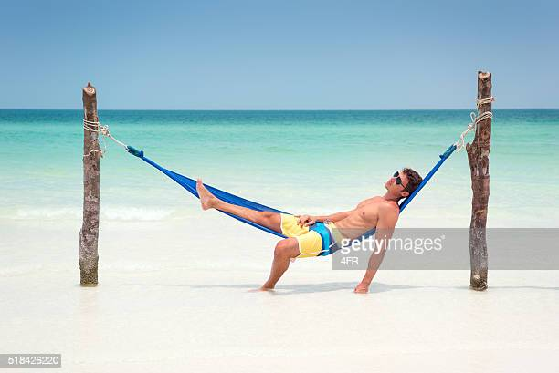 Man relaxing in a Hammock on a Tropical Island