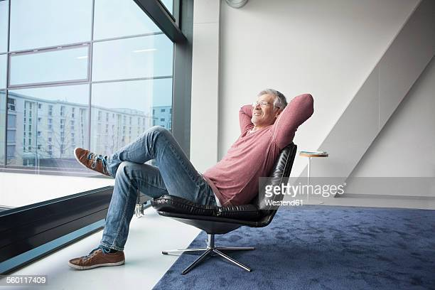 Man relaxing in a leather chair at home