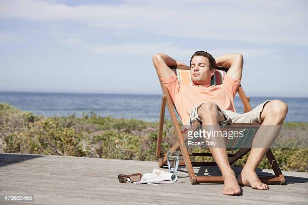 Man relaxing in a lounge chair