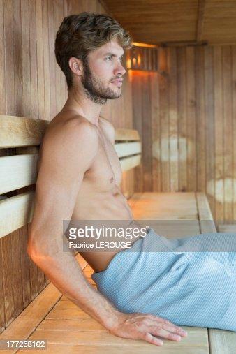 Sauna Details In 2019: Man Relaxing In A Sauna Stock Photo