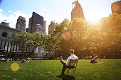 Man relaxing in Bryant Park, Manhattan