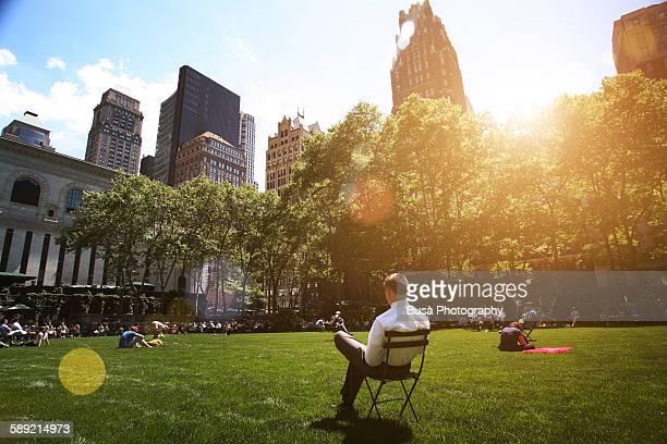 Man relaxing in Bryant Park, Manhattan