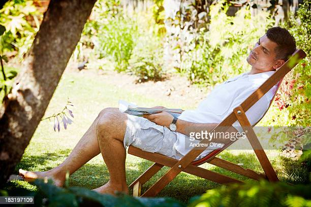 Man relaxing in chair at home