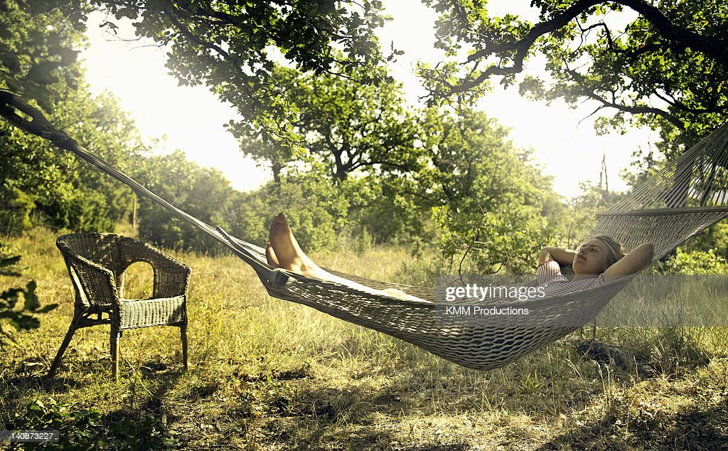 Man relaxing in hammock outdoors : Stock Photo