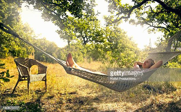 Man relaxing in hammock outdoors