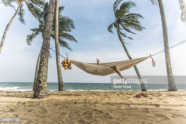 Man relaxing in hammock.