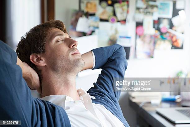 Man relaxing in home office