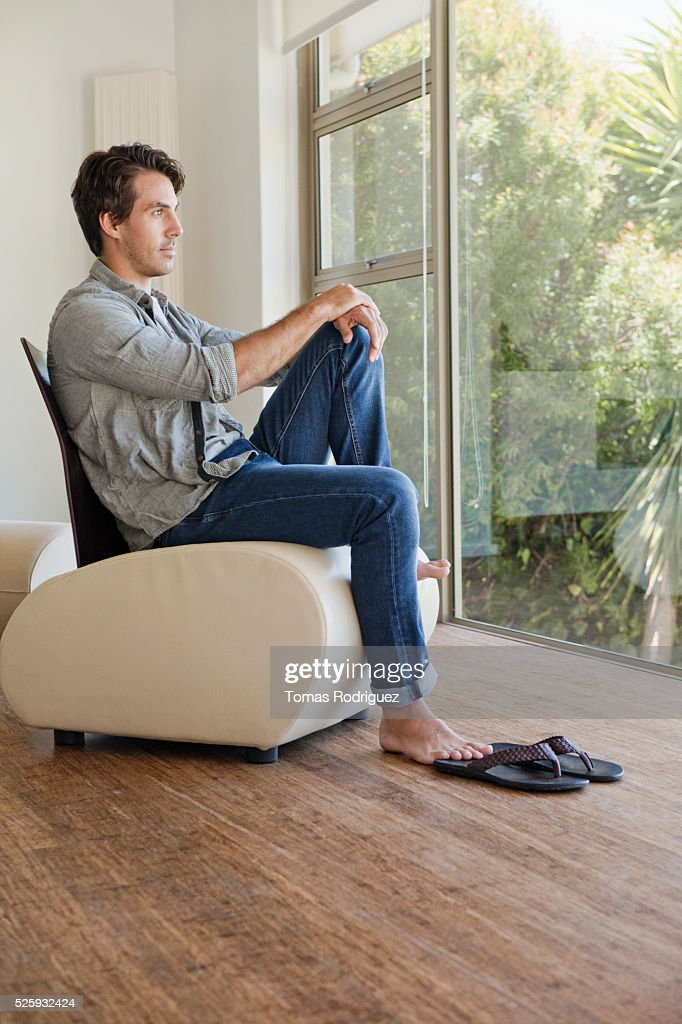Man relaxing in room : Stock Photo