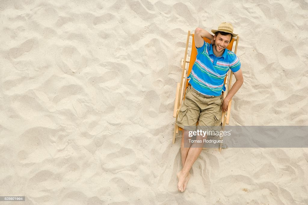 Man Relaxing on a Beach : Stock Photo