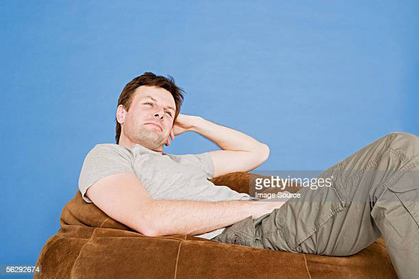 Man relaxing on a beanbag