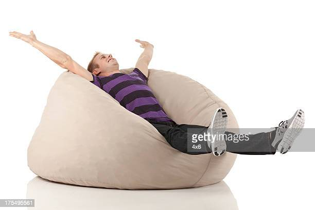 Man relaxing on bean bag
