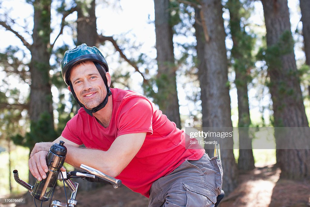 Man relaxing on bicycle : Stock Photo