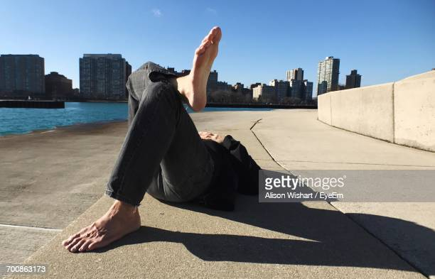 Man Relaxing On Lakeshore In Chicago