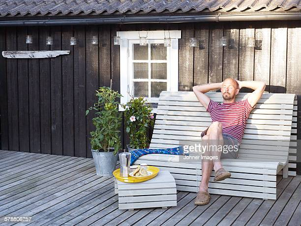 Man relaxing on patio