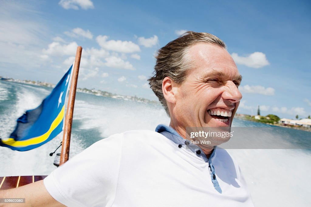 Man relaxing on speedboat : Photo