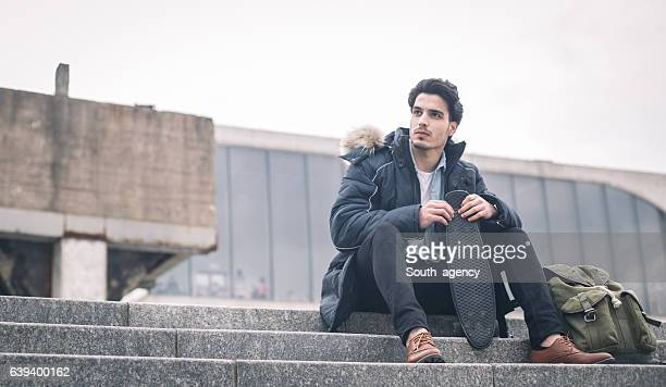 Man relaxing on the steps
