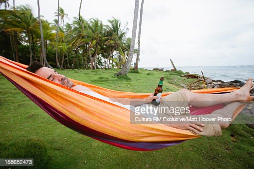 boat hammock man relaxing with beer in hammock stock photo getty images