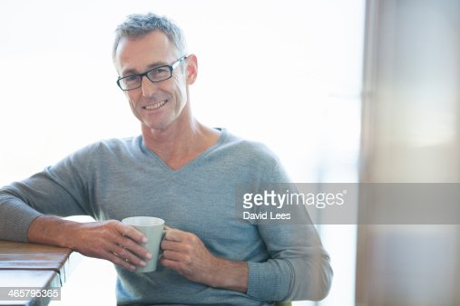 Man relaxing with cup of coffee