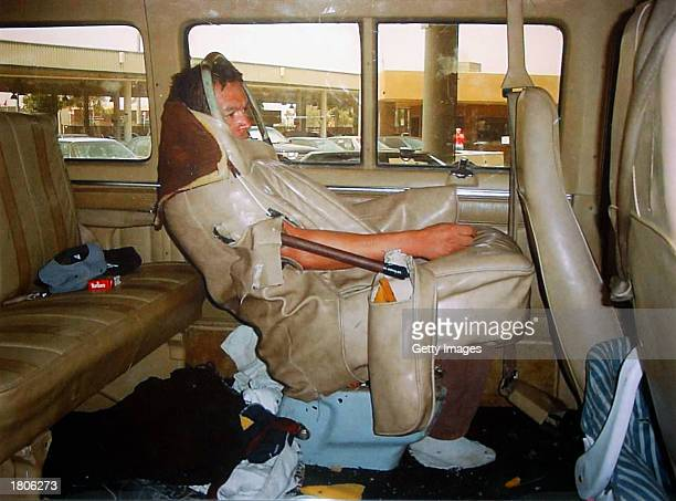 A man remains sewn into the back seat of a van where he was discovered trying to be smuggled into the US from Mexico in this photo provided by...