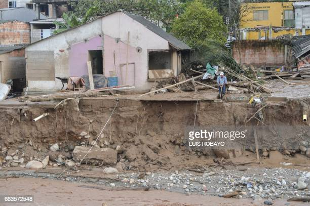 A man removes mud left by mudslides following heavy rains in Mocoa Putumayo department southern Colombia on April 1 2017 Massive mudslides left more...