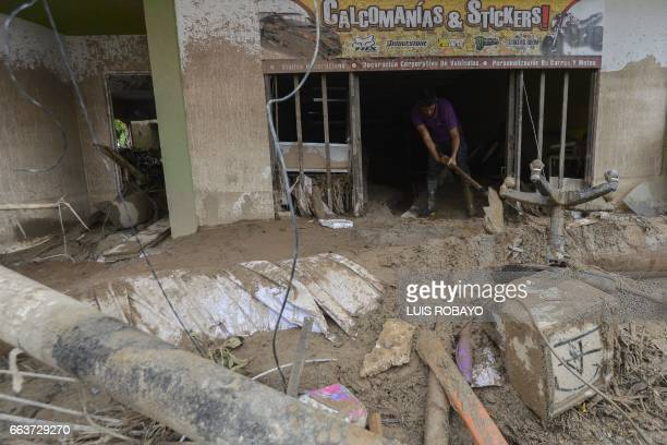 A man removes rubble left by mudslides following heavy rains in Mocoa Putumayo department southern Colombia on April 2 2017 The death toll from a...