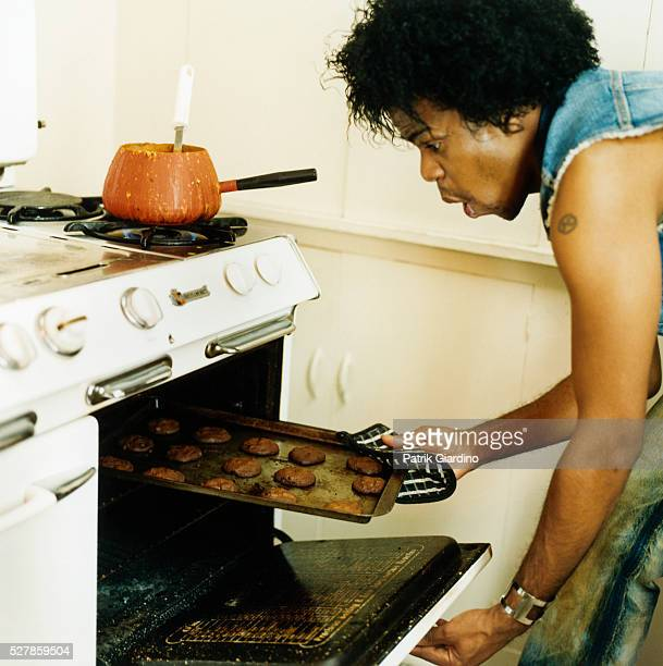 Man Removing Cookies from Oven