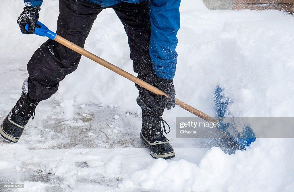 Man Removing Snow with a Shovel : Stock Photo