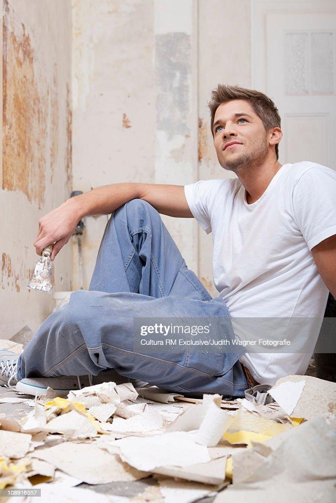 Man renovating room : Stock Photo