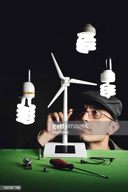 Man repairing a small wind turbine