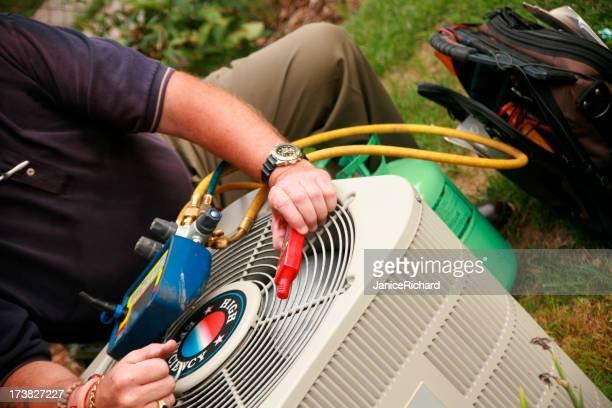 A man repairing an air conditioner