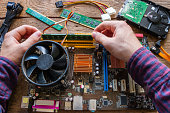 man repairing computer hardware