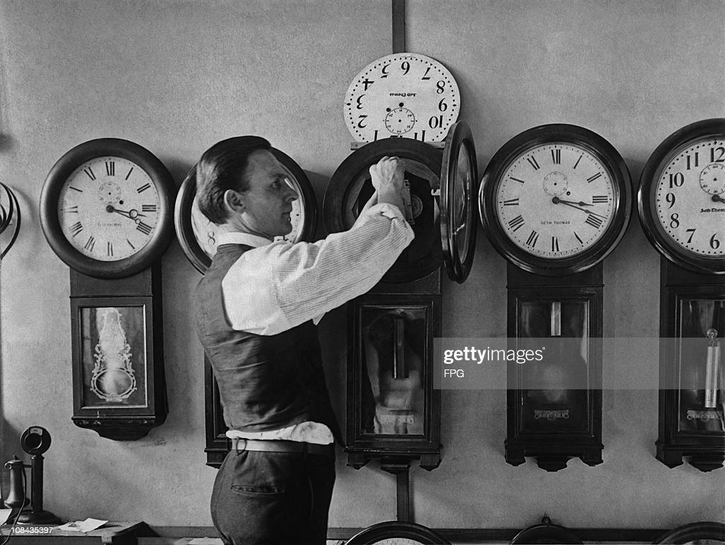 A man repairing one of the many clocks at the US Treasury in Washington D.C. circa 1930.