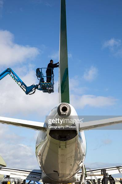 Man repairing plane Cotswold Airport Cirencester Gloucestershire England UK