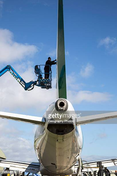 Man repairing plane Cotswold Airport Cirencester Gloucestershire England UK