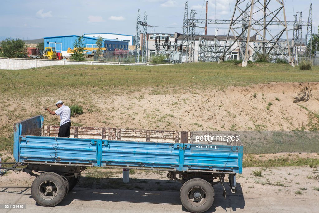 A man repairs a truck trailer outside the Darkhan Metallurgical Plant in Darkhan, Mongolia, on Monday, Aug. 14, 2017. Mongolia, desperate to make more of its abundant resources as it seeks to revive its flailing economy, aims to make that vision a reality through one of the world's most ambitious power projects. The landlocked nation is considering a $7 billion plan to build coal, wind and solar plants that could send electricity across China, Russia, South Korea and Japan, according to the Shivee Energy Complex. Photograph: Taylor Weidman/Bloomberg via Getty Images