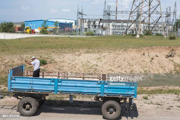 A man repairs a truck trailer outside the Darkhan Metallurgical Plant in Darkhan Mongolia on Monday Aug 14 2017 Mongolia desperate to make more of...