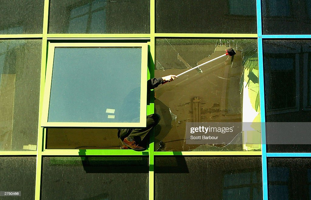 A man repairs broken windows near the scene of the British Consulate bombing November 21, 2003 in Istanbul, Turkey. Bomb attacks on the British consulate and the HSBC bank headquarters on November 20, 2003 killed at least 27 people and left hundreds injured.