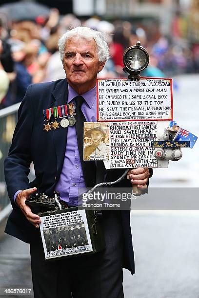 A man representing his father walks down Bathurst Street during the ANZAC Day parade on April 25 2014 in Sydney Australia Veterans dignitaries and...