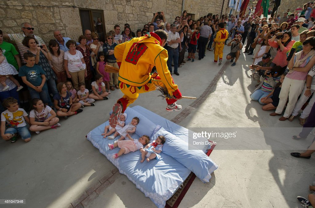 A man representing the devil leaps over babies during the festival of El Salto del Colacho (the devil's jump) on June 22, 2014 in Castrillo de Murcia, Spain. The festival, held on the first Sunday after Corpus Cristi, is a catholic rite of the devil cleansing babies of original sin.